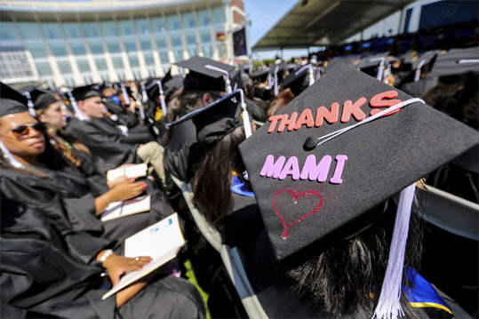 A graduate's cap read, 'Thanks Mami,' during the University of Massachusetts Boston's commencement.