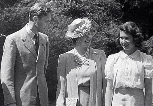 King George VI with his wife Queen Elizabeth and daughter (then Princess) Elizabeth.