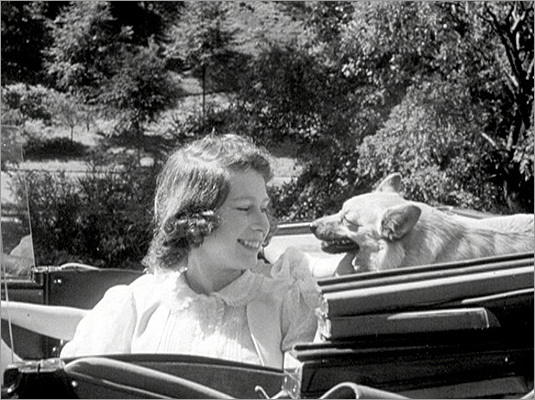 Queen Elizabeth II's Diamond Jubilee will take place June 2-5 with a series of celebrations and events to celebrate her reign. In honor of the event, here is an intimate look back at Queen Elizabeth II's younger years as princess, a mother, and a new leader. Pictured: Then Princess Elizabeth in the back seat of a car at Windsor Castle in 1941.