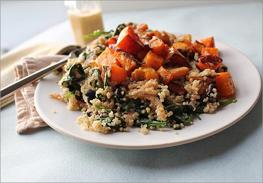 Quinoa black bean and spinach salad with butternut squash and chipotle vinaigrette.