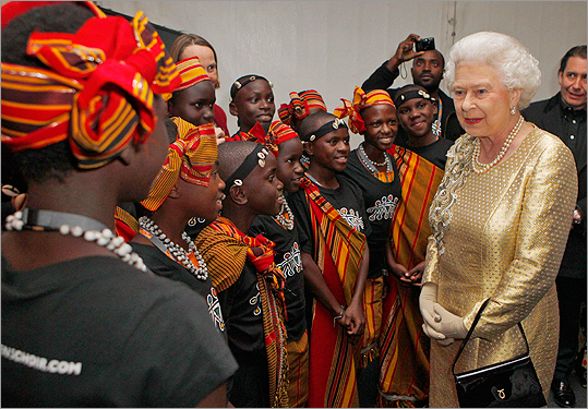 Queen Elizabeth II with dancers from Kenya backstage after the Diamond Jubilee concert.