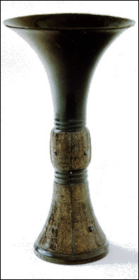 Chinese bronze beaker or 'Ku', Chinese Shang Dynasty, 1200-1100 B.C. Stolen from the Dutch Room. Height of 10 ', diameter of 6 1/8', with a weight of 2 pounds, 7 ounces. More information at the FBI Art Theft Program website.
