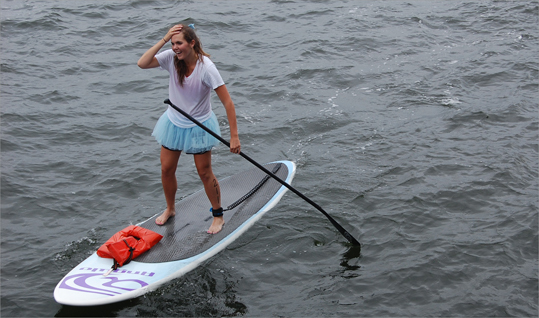Some stand up paddlers in the open race, like Cecily Cushman of Marblehead, came out just to have fun. It's not every day you get to navigate Boston Harbor next to State Police boats and a fishing ship named the Iron Lady as schooners sail by in the distance.