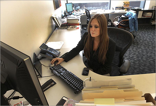 Meagan O'Hara at her desk at Fort Point Project Management.
