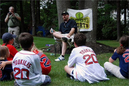 2008 Youkilis continued to spend time in the community. Here he answered questions from the Glynn family in Milton during a visit for 'Good Sports,' a charity that provides athletic equipment to disadvantaged children. The Glynns bid on his visit at an auction to support the cause.