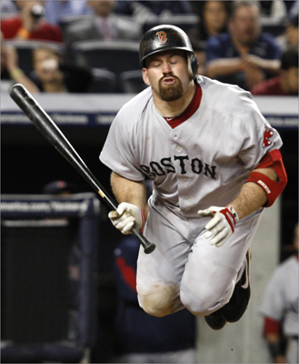 2010 Here Youkilis leapt to avoid a close pitch thrown by Yankee Phil Hughes. The one good thing about missing games? Fewer opportunities to get drilled. He was hit just 10 times by pitches in 2010.