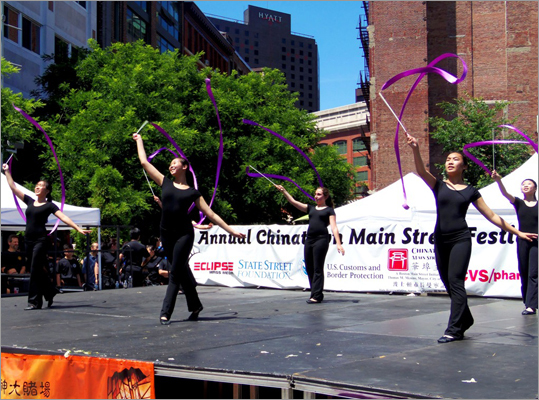Young women performed a ribbon dance on the stage at Chinatown Park.