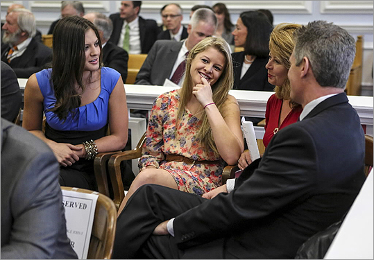 Ayla Brown, Arianna Brown, Gail Huff, and Senator Scott Brown sat together during a Law Day celebration held at Wrentham District Court.