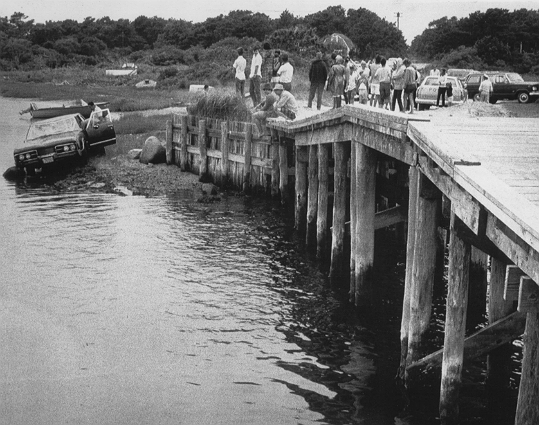 On the evening of July 18, 1969, a car driven by Sen. Edward M. Kennedy went off the side of a bridge on Chappaquiddick Island, off the shore of Martha's Vineyard. His passenger, Mary Jo Kopechne, was found dead; many facts from that point forward have been disputed for decades. Kopechne's body was found in the morning by local fishermen, but Kennedy didn't report the crash to police for almost 11 hours. At left: Sen. Edward M. Kennedy's car after it went off the bridge on Chappaquiddick Island, killing Mary Jo Kopechne.
