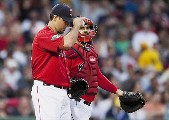 Josh Beckett and catcher Kelly Shoppach talk on the mound in the second inning, when Beckett had already given up four runs to the Blue Jays.