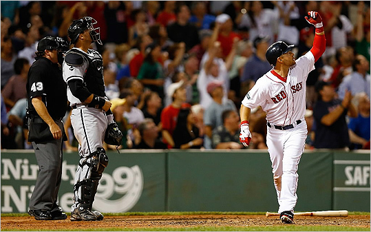 Cody Ross dropped his bat and watched the ball after hitting the game winning walk-off three-run home run in the bottom of the ninth inning against the Chicago White Sox July 19.