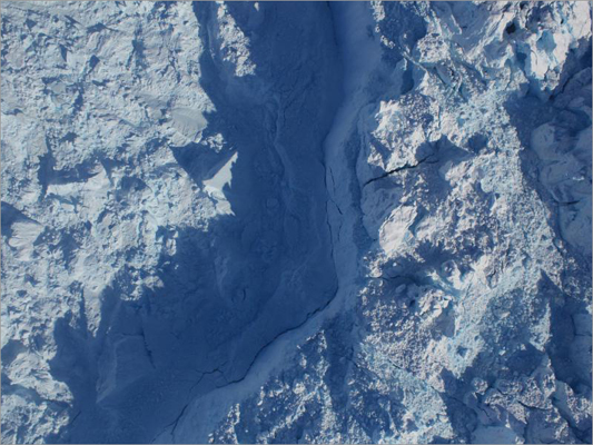 On April 6, IceBridge flew over Jakobshavn, Greenland's fastest-moving major glacier. This image was captured by a camera looking down through a window in the base of the aircraft.