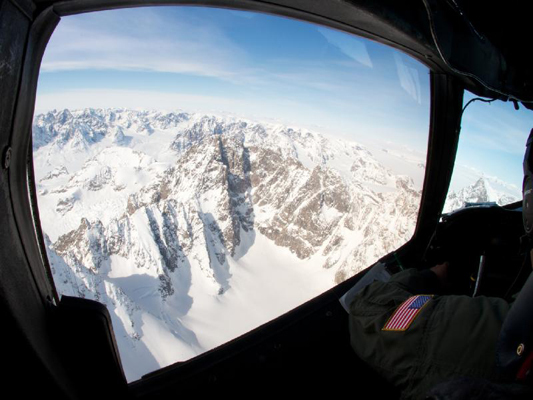 A NASA pilot flew a P-3B aircraft over mountains in eastern Greenland on Apr. 14 as part of Operation IceBridge's campaign to measure Arctic ice. IceBridge, now in its third year, makes annual campaigns in the Arctic and Antarctic, where science flights monitor glaciers, ice sheets, and sea ice.