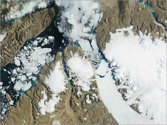 Researchers have been using NASA data to calculate how much Earth's melting land ice is adding to the rise in sea levels worldwide. Earlier this year, NASA said ice loss from Greenland, Antarctica, and their peripheral ice caps and glaciers averaged 385 billion tons a year. For several days this July, Greenland's surface ice melted over a larger area than at any time in more than 30 years of observations. Nearly the entire ice cover of Greenland, from its thin coastal edges to its two-mile-thick center, experienced some degree of surface melting, according to NASA. The melting spread quickly. Melt maps derived from the three satellites showed that on July 8, about 40 percent of the ice sheet's surface had melted. By July 12, 97 percent had melted. In addition, a 12.5-mile swath of ice broke off this month and headed out to sea. Click through to see images and video of what's happening in Greeland and Antarctica.