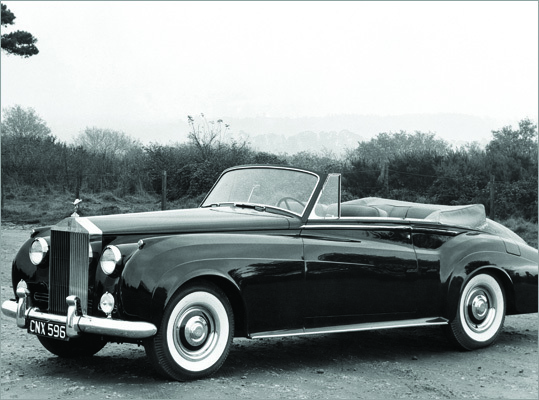 Rolls-Royce Silver Cloud Manufactured from 1955-1966, the Silver Cloud carried on Rolls-Royce&#146;s tradition for luxury convertibles. In 1965, this car sold for $8,000. It was designed by John Blatchley &#151; also responsible for the similar looking Bentley S1 &#151; and assembled in Crewe, England. Each Silver Cloud weighed more than two tons and took three months to build.