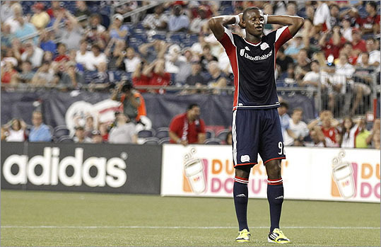 Dimitry Imbongo of the New England Revolution reacted to missing a shot against Sporting KC during the first half at Gillette Stadium.