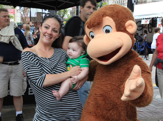 One family posed with Curious George.