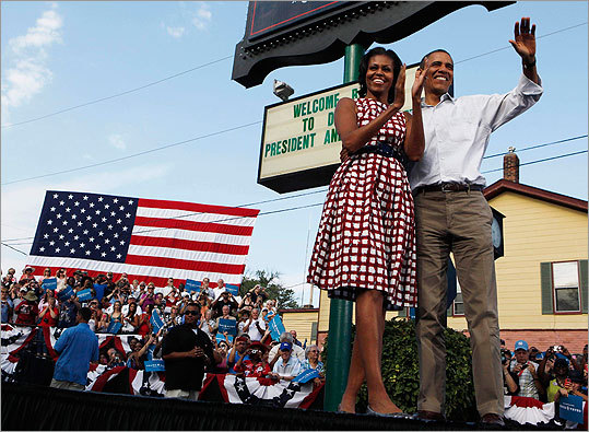 Michelle Obama wore a red and white checkered dress as she and the president addressed supporters in Davenport, Iowa, on Aug. 15.