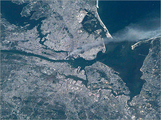A plume of smoke rose from the World Trade Center site in this NASA satellite photo from Sept. 11, 2001.