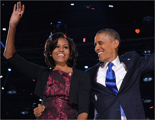 Mrs. Obama topped off her dress with a black shrug that showed a peek of a vintage pink brooch from House of Lavande.