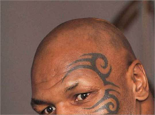 Which retired sports star has a tattoo around his left eye?
