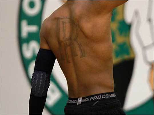 Which NBA star has 'RR' inked on his back?