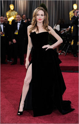 Angie's Right Leg Apparently, flashing most of your leg leads to Internet viraldom. Angelina Jolie showed off on the red carpet of the Oscars. Then, her leg developed a Twitter account .