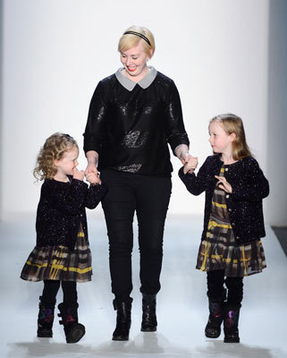 Boston-based designer Jackie Fraser-Swan walked the runway with two of her daughters at the end of her Emerson fall 2013 show at Lincoln Center on Feb. 10.