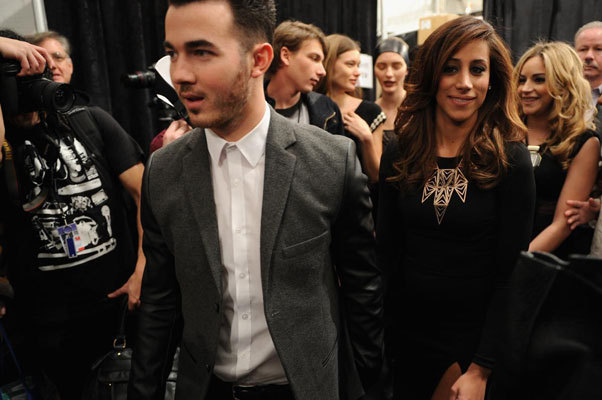 Singer Kevin Jonas of The Jonas Brothers and his wife, Danielle Deleasa, walked backstage at the Pamella Roland 2013 Fall show.