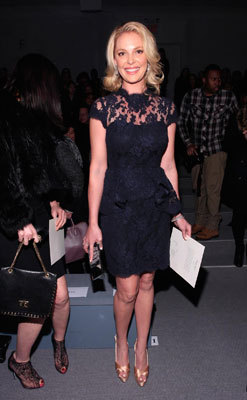 """Knocked Up"" actress Katherine Heigl smiled at the Reem Acra Fall 2013 show."