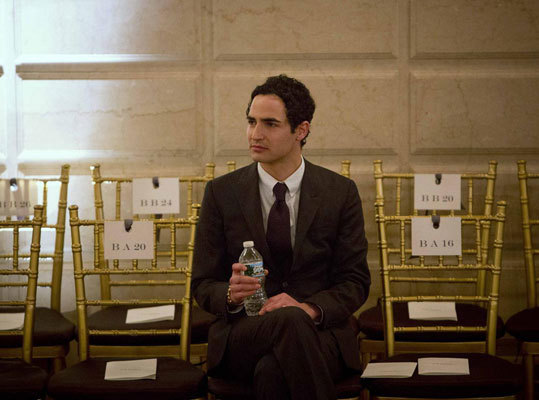 Designer Zac Posen watched models rehease on Feb. 10 before his collection's salon-style show at the Plaza Hotel.