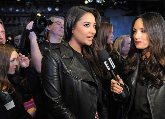 """Pretty Little Liars"" star Shay Mitchell was interviewed on the runway before the showing of the DKNY Fall 2013 collection on Feb. 10."