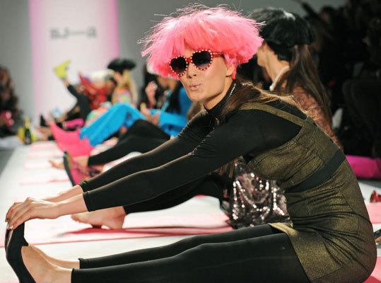 """According to the Wall Street Journal , Johnson """"made the [Feb. 11] show her own, lining the runway with pink yoga mats, colorful sneakers, exercise bands and champagne bottles that were used as weights."""""""