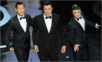 From left: Actors Joseph Gordon-Levitt, host Seth MacFarlane, and Daniel Radcliffe performed together at the Dolby Theatre in Los Angeles.