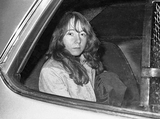 Lynette 'Squeaky' Fromme, a member of the Manson Family, attempted to assassinate President Ford on Sept. 5, 1975. She's pictured here in custody of the U.S. Marshals, in Sacramento, Calif., Nov. 25, 1975. Fromme also attempted to contact Led Zeppelin guitarist Jimmy Page to warn him of 'bad energy' that year.