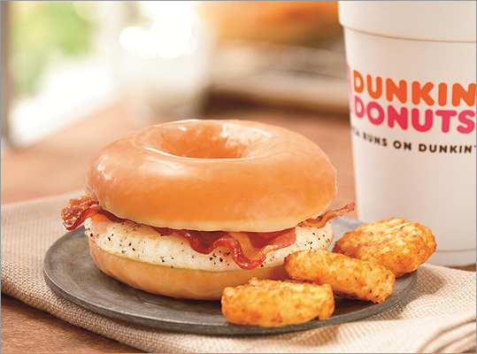 Dunkin' Donuts Glazed Donut Breakfast Sandwich Early April brought news of this creation , being served for a limited time in a handful of eastern Massachusetts Dunkin' Donuts locations. It comes on the heels of a similar offering from the Pittsburgh Pirates . The morning radio crew at WZLX did an on-air tasting; click here to listen to their feedback. Will you try the new glazed doughnut breakfast sandwich?