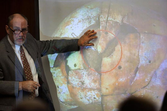 Forensic pathologist Frank Sheridan pointed to a projection of the skull of John Sohus during Gerhartsreiter's preliminary hearing at the Alhambra courthouse on Jan. 18, 2012.