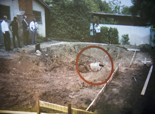 A photo of the unearthed swimming pool area where the remains of John Sohus were found in 1994 were shown during final arguments by prosecutor Habib Balian on April 9.