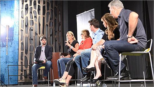 The Boston Globe's Glenn Yoder (far left) moderated the panel.