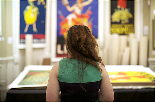 One participant looks at the art at the International Poster Gallery.