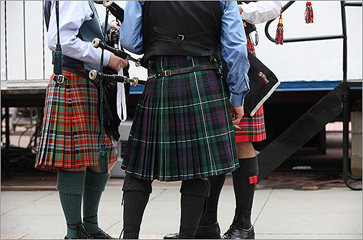 Bag pipers in kilts lingered offstage before heading out to perform.