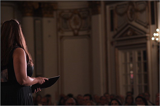 A member of the Handel and Haydn Society sings for the crowd in the Grand Ballroom of the Fairmont Copley Plaza.