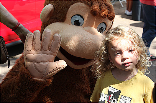 WGBH characters were also at Copley on Saturday. At left, one child poses with Curious George.