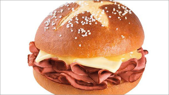 Dunkin' Donuts Pretzel Roll Roast Beef sandwich Dunkin's latest venture into non-donut fare is the Pretzel Roll Roast Beef sandwich , featuring white cheddar cheese and dijon mustard. Will you pick up a Pretzel Roll Roast Beef sandwich for lunch?