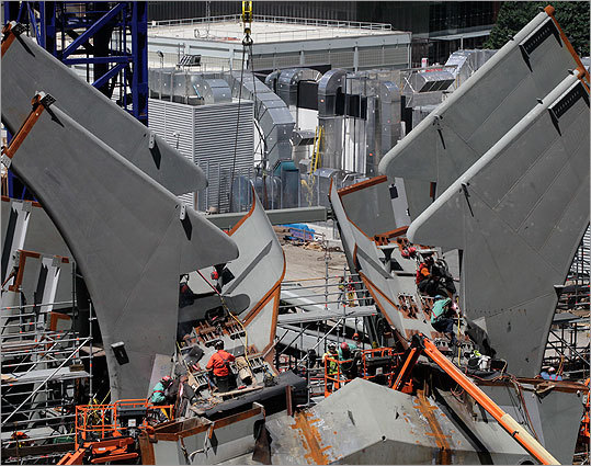 The World Trade Center's transportation hub remains under construction and is expected to be completed in 2015.