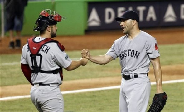 Boston Red Sox relief pitcher Alfredo Aceves, right, is congratulated by catcher Kelly Shoppach after Boston's 2-1 win against the Miami Marlins during an interleague baseball game in Miami, Tuesday, June 12, 2012.