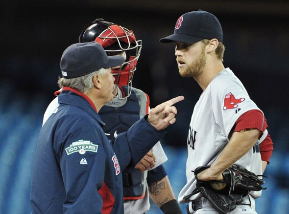 Boston Red Sox pitching coach Bob McClure talks to pitcher Daniel Bard during the third inning of their MLB American League baseball game against the Toronto Blue Jays in Toronto April 10, 2012.