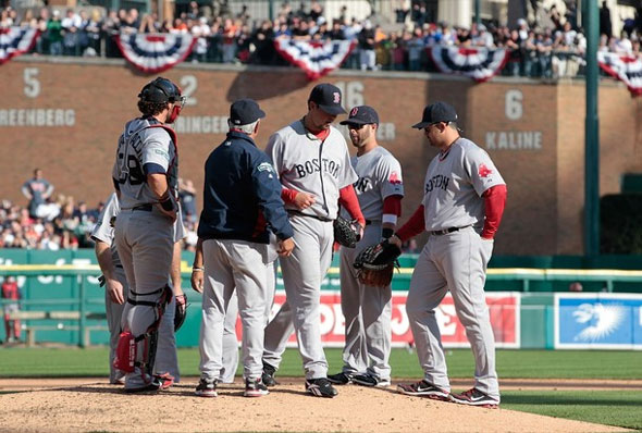 Josh Beckett of the Boston Red Sox is replaced in the fifth inning by manager Bobby Valentine during the game against the Detroit Tigers at Comerica Park on April 7, 2012 in Detroit, Michigan.