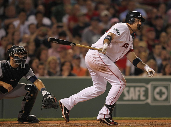 Adrian Gonzalez of the Red Sox doubles to knock in the go-ahead run in the seventh inning against the Detroit Tigers at Fenway Park May 30, 2012 in Boston, Massachusetts.