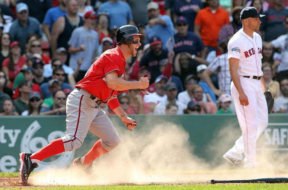 Bryce Harper of the Washington Nationals scores the go-ahead run in the ninth inning as pitcher Alfredo Aceves of the Boston Red Sox looks away during interleague play at Fenway Park June 10, 2012 in Boston, Massachusetts.